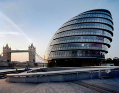 City Hall is a real landmark of modern London, a great curved glass structure that sits like a moored ship on the south bank of the Thames. Description from aquamarkcleaning.co.uk. I searched for this on bing.com/images