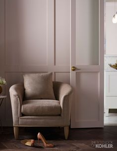 Blush pink in both the powder room and the seating area make the two areas feel connected.