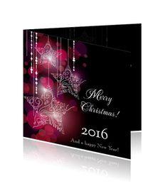 Kerstkaarten op Pinterest met witte kerststerren en paarse achtergrond.