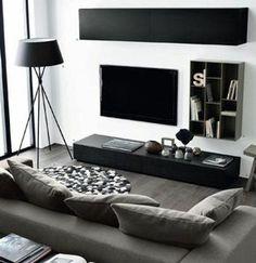 salon en noir, blanc et gris, idee deco salon aux lignes épurées, peinture murale blanche, canapé gris, lampe et meuble tv noirs, amenagement salon sobre et moderne