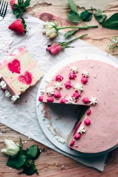 This White Cake with Strawberry Frosting is the perfect cake for Valentine's Day. Watch the step-by-step video to make this beautiful and delicious cake.