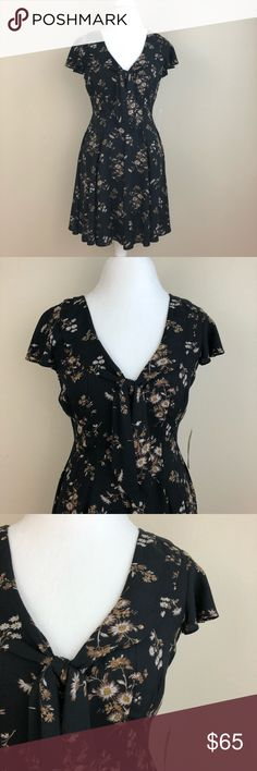 """Denim & Supply Ralph Lauren Flower Print Dress Denim & Supply Ralph Lauren flower print dress. Fit and flare style. Zipper down back. 100% viscose. Length 32 1/2"""", width pit to pit 17 1/2"""", waist 27"""". Measurements are approximate. Machine wash. New with tag. Denim & Supply Ralph Lauren Dresses Midi"""