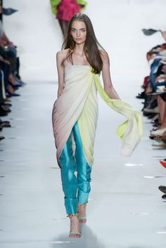 Love this look of a sarong wrapped as a top- tied at underarm and worn over pants.