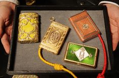 Faberge Cigarette Cases Smuggled out of Russia in 1917  This collection of Faberge cigarette cases was smuggled out of Russia in pillowcases during the 1917 revolution. The cases belonged to Maria Pavlovna, Grand Duchess Vladimir, and her husband, Grand Duke Vladimire Alexandrovich, brother of Alexander III. The case in the upper left sold for $890,000, more than anticipated.