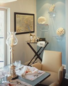 """Staged to sell beach style dining room. Love the """"bar"""" and the shelves for the coral."""