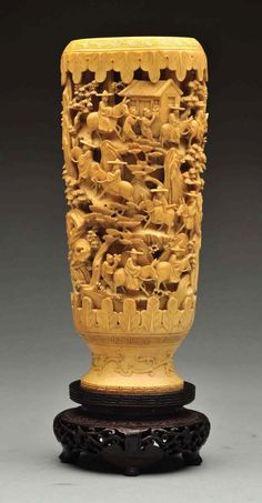 """Exquisitely carved with miniature men riding donkeys up a mountain to reach the houses at the top. Very fine carving, in great detail. One of the finest miniature carvings we have seen. 7"""" tall excluding the base. No damage. Condition (Excellent). Size 8 - 1/4"""" T."""