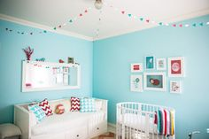 Aqua and Red Nursery - we love the idea of putting a daybed in the nursery for parents to crash on a rough night!