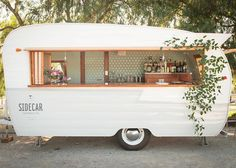 This would be awesome to make and rent out for events. Outdoor barn wedding, with a camper bar. SO perfect!