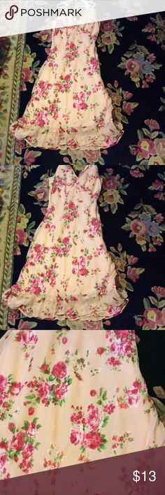 Sweet pink floral stretchy dress Pink sheer material with beautiful floral design and tiny beadwork through out with a ruffled hem it has a halter top the size says large but I think it's more medium Dress Barn Dresses Midi
