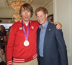 Prince Harry poses with two-time Olympic rowing medallist Malcolm Howard at Canada Olympic House, London, Thursday Aug. 2, 2012.  Canadian Olympic Committee Photo