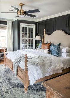 A plain, dated master bedroom gets a modern vintage makeover with moody black paint, modern textures, vintage style furniture, and budget DIY projects. #bedroom #makeover