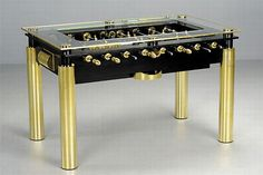 LuxGold Table: uses only the highest-quality materials, like stainless steel and unbreakable glass to create a beautiful yet durable table that will last generations. Choose between 50 different colors for the table's accents, and from 12 different styles and materials for the men, to give your game room a unique centerpiece. http://www.billiardfactory.com