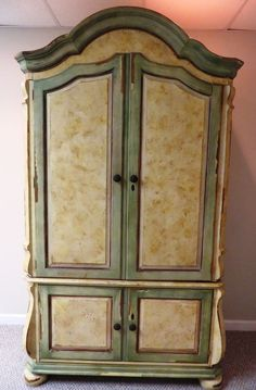 Very Fine Domain Armoire. Hand Painted Distressed Finish In Ivory And  Greens With Oil Rubbed Bronze Knobs. 4 Doors With Storage On Bottom. Doors  Have Double ...