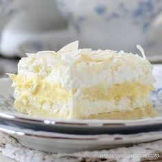 Coconut Cream Layered Dream | low carb, gluten-free Recipe Desserts with crust, almond flour, shredded coconut, vanilla whey protein powder, erythritol, salted butter, pudding, vanilla pastry cream, cream cheese, cream cheese, almond milk, erythritol, whipped cream, heavy cream, erythritol, vanilla, coconut, unsweetened shredded dried coconut