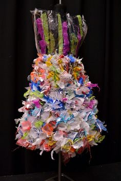 An anti fashion piece. Which was created from the theme memory. I used recyle material like bags and paper.  Which was made into individual flowers that contains one memory.