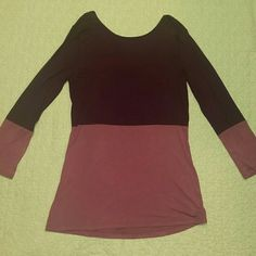 """BCBG Long Sleeved Tunic Beautiful lightweight long sleeved """"knit sportswear top"""" in """"Merlot Combo"""" color. Approx 27 inches from shoulder to bottom. 100% Rayon and feels super soft! The back of the neck swoops down (pic 2). BCBG Tops Tunics"""