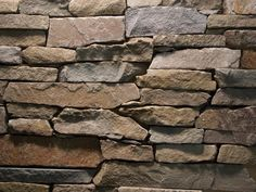 stone siding to complement red brick and patio deck Harbour Mist Ledge Stone Veneer