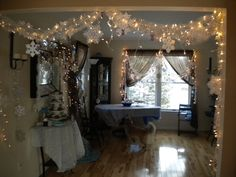 Lights and snowflakes, maybe cotton balls and streamers too for the girls frozen party.