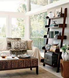ladder bookshelf and animal print pillows