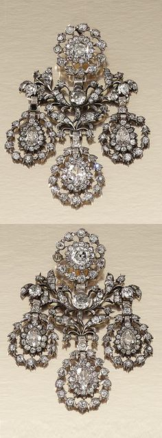 A PAIR OF ANTIQUE DIAMOND EARRINGS, SECOND HALF OF 18TH CENTURY. Of girandole design, each surmount designed as a flower head cluster, suspending an open work plaque, set throughout with circular-cut and pear-shaped diamonds to three similarly set detachable pear-shaped drops with swing centres.