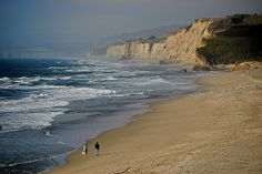 Couple taking a walk at the Pescadero state beach. San Mateo County, California 2005