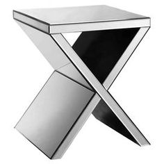"""Display a lush floral arrangement and framed family photos atop this eye-catching metal accent table, showcasing an x-shaped base and mirrored finish.      Product: Accent tableConstruction Material: Metal and mirrored glassColor: SilverFeatures: X-shaped baseMirrored finishDimensions: 20"""" H x 16"""" W x 16"""" D"""