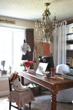 Give your home office romantic flair by replacing your lighting fixture with a chandelier. #romantichomes
