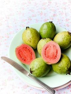 Guava fruit is rich in vitamin a, and vitamin c. A single guava has four times the amount of vitamin c as an orange. The ripe fruit is also a rich source of antioxidants. In addition the seeds have high levels of and Fruit And Veg, Fruits And Vegetables, Fresh Fruit, Guava Benefits, Health Benefits, Photo Fruit, Guava Tree, Comida Latina, Nutrition