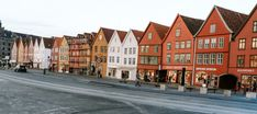 One of the best things to see in Bergen is the famous Bryggen, the colourful houses in Bergen. Norway Facts, Visit Bergen, Norway Travel Guide, Famous Fish, Wooden Buildings, Local Events, 14th Century, Nice View, House Colors