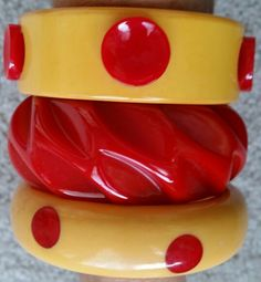 Red and ivory vintage bakelite bracelets.