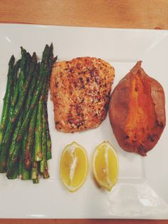 This looks delicious!! -- Paleo dinner: Salmon, asparagus (could sub in green beans), and sweet potato.