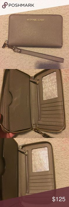 BRAND NEW Michael Kors Wallet/Wristlet This is a Michael Kors Jet Set wallet with detachable wristlet in the color Dark dune! It has a spot for coins, can fit 7 cards, cash, and has a large pocket on other side for cell phone (fits an IPhone 6)❤ BRAND NEW NEVER USED CONDITION!! Michael Kors Bags Wallets