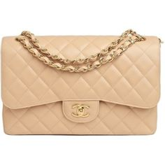 Hilary Duff style. Chanel Beige Quilted Caviar Jumbo 2.55 Flap Bag Never Carried. View this product here http://wheresthatstyle.com/products/12061-chanel-beige-quilted-caviar-jumbo-2-55-flap-bag-never-carried