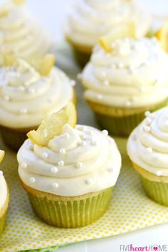The BEST Lemon Cupcakes ~ start with a simple one-bowl batter and end with a soaking of lemon simple syrup and a topping of fluffy Lemon Cream Cheese Frosting for luscious, lemony, perfectly moist treats! | FiveHeartHome.com