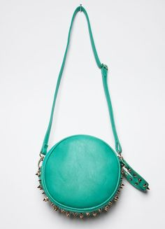 241 Turquoise circle clutch-style purse that features gold metal spikedetail and handle with zipper closure