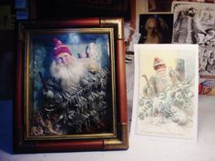 A shadowbox inspired by a Christmas card. Santa tramping through woods.   decamp