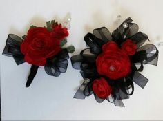Red & Black wrist corsage and boutonniere By Bride & Bloom Gladwin, Michigan
