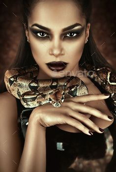 Close up portrait of sexy woman with snake in latex outfit