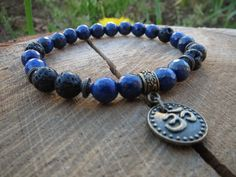 Check out this item in my Etsy shop https://www.etsy.com/listing/231008478/lapis-lazuli-ohm-om-bracelet-black-lava