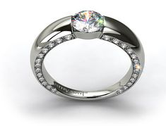 Modern tension-set engagement ring with a thick bar shank and pave diamonds decorating the outer part of the setting
