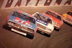 NASCAR cars during race at the Daytona International Speedway racetrack (ca. 1970). | Florida Memory