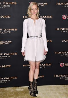 Jennifer Lawrence wears a white shirt dress from the Christian Dior Haute Couture Fall 2015 collection.