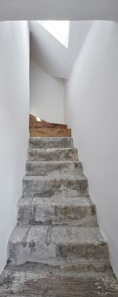 Love these stairs and the light.In transforming a century-Czech Republic residence into this guesthouse, local studio ORA celebrated an assortment of original details including old plasterwork, semi-circular windows and stone steps. Interior Stairs, Interior Architecture, Interior And Exterior, Stone Interior, Stairs Architecture, Stone Stairs, Concrete Stairs, Stair Detail, House Stairs