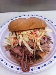 Pulled pork sandwich on a toasted kaiser and topped with homemade coleslaw. You'll be back for more
