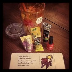 End of year teachers gift...cup, lemonade, lip sunscreen, soothing foot lotion and toe nail polish.  TO SIT BACK AND RELAX ALL SUMMER LONG! :)