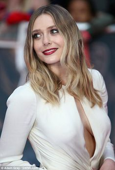 The Avengers: Age of Ultron star injected the event with a welcome dose of glamour in a white gown that had been given a daring twist with gaping keyhole detailing