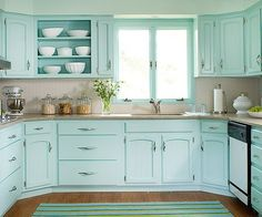 I'm in love with the mint colored kitchen! With a bright colored island in the middle, this would be stunning