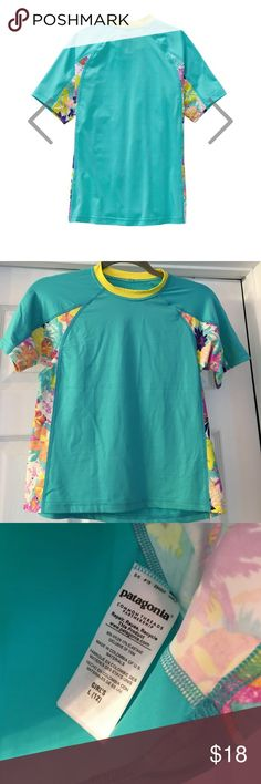 ☀️ Patagonia girls' Rushguard top ☀️ BNWOT , Patagonia girls' rushguard top. Built for one-the-water sun and chill protection in a nylon/spandex blend with 50+ UPF sun protection.Aqua color with floral tropical print inserts. Patagonia Swim Rashguards