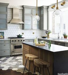 Love the look of this stove and hood. We can look at options on the hood design. Doesn't have to be stainless.  Don't like the flooring in this pic.