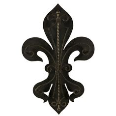Fleur-De-Lis Two Layer Wall Plaque is beautifully crafted from iron with natural finish. Inspired by a French coat -of-arms, this dimensional piece can be displayed alone or in a grouping.